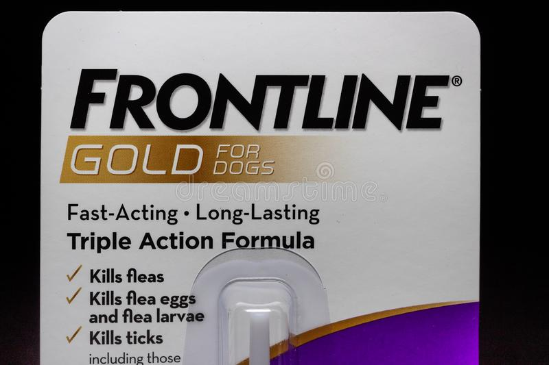 Frontline Gold Container and Trademark Logo. ST. PAUL, MN/USA - MARCH 16, 2019: Frontline Gold flea and tick preventative medicine for dogs and trademark logo royalty free stock image
