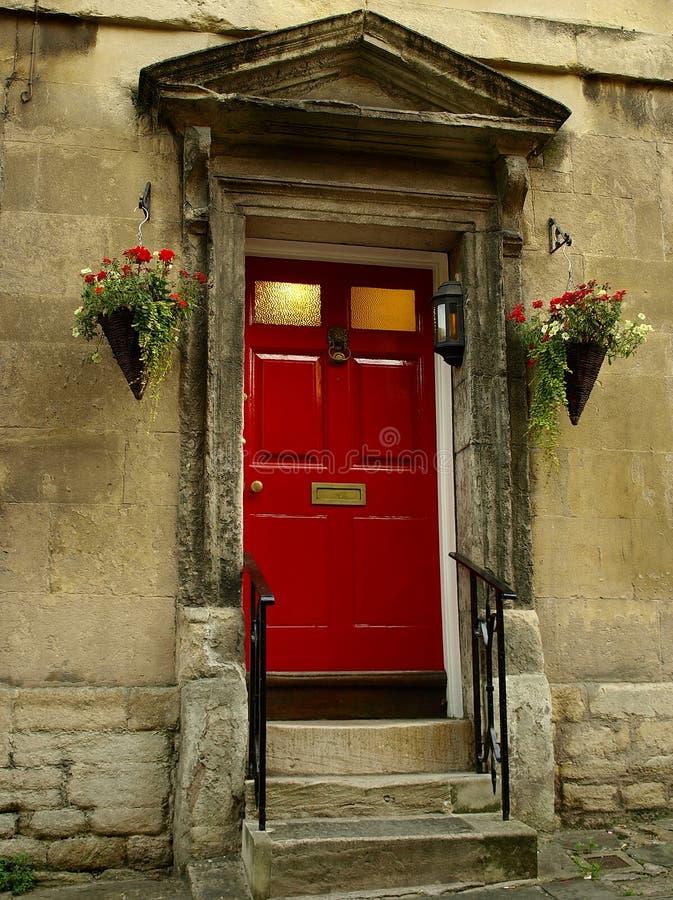 Download Frontowa drzwi czerwień zdjęcie stock. Obraz złożonej z pensjonat - 10781474