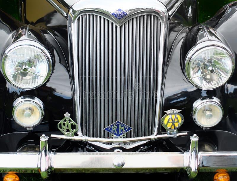 Frontowy szczegół czarny rocznika Riley motorcar z rekordowym reflektoru grzejnikiem, odznakami i fotografia stock
