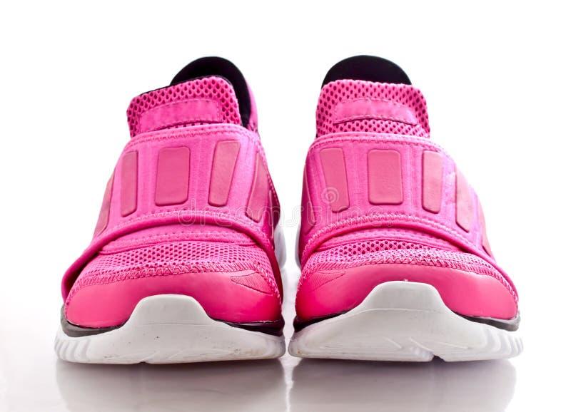 Frontowy widok para różowej damy sporta buty fotografia royalty free