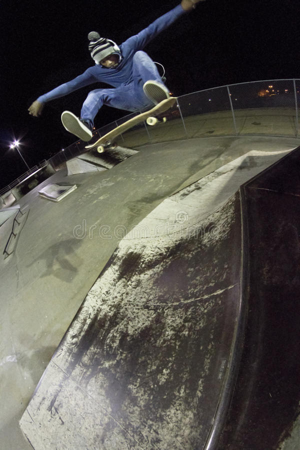 Frontside Kick flip Air stock photography