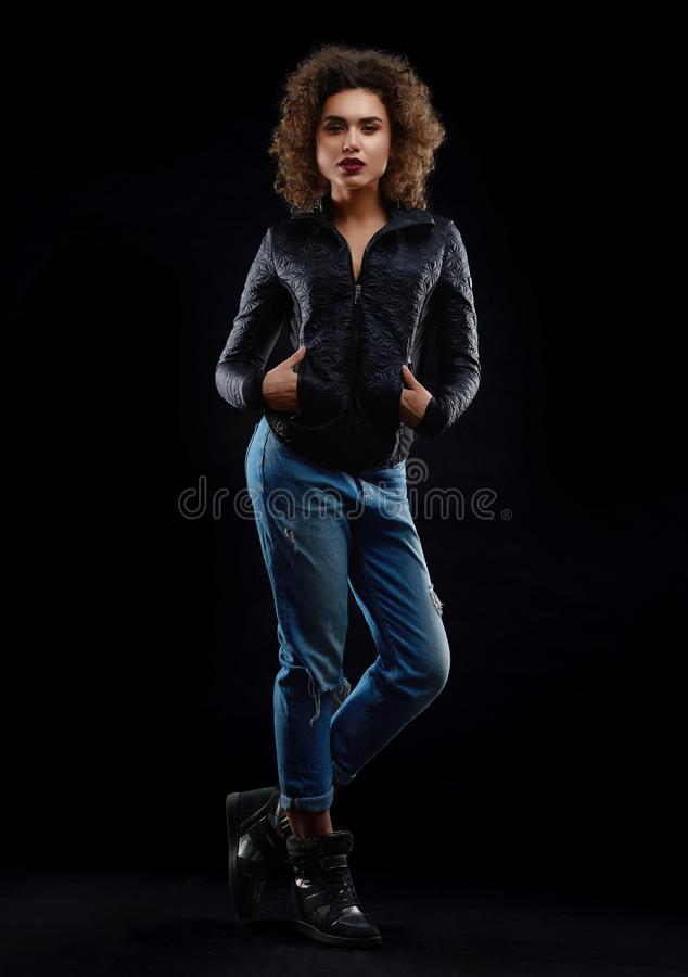 Frontview of curly girl dredded in stylish clothes. royalty free stock photography