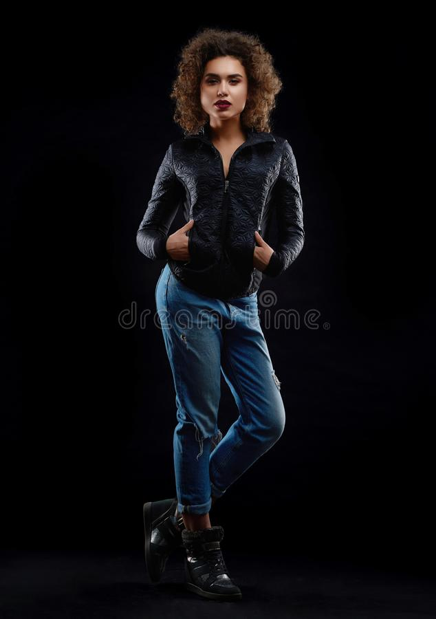Frontview of curly girl dredded in stylish clothes. stock photos