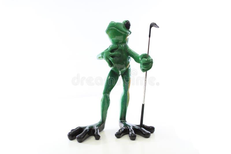 Froschgolfspielerfigürchen stockbild