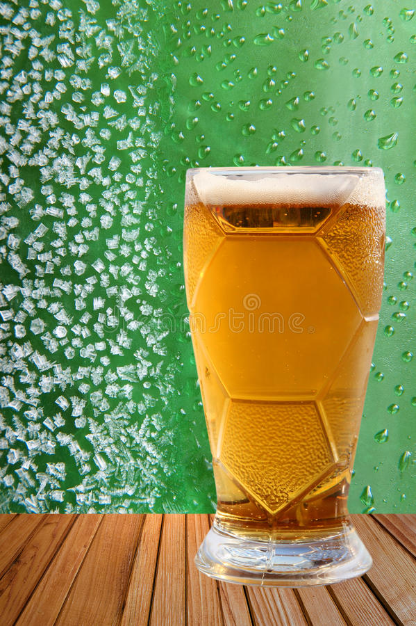 Frost beer glass against of ice crystals and drips green backgro royalty free stock photography