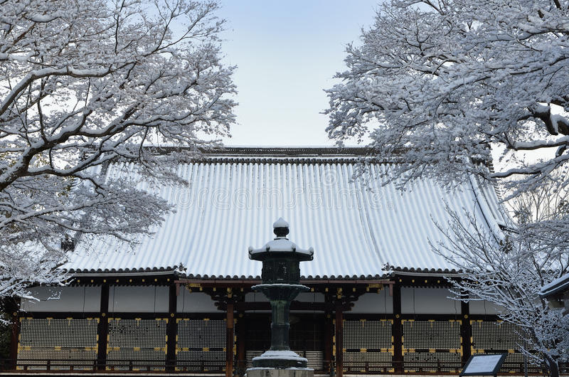 Frost covered temple, winter in Kyoto Japan. In winter, landscape of falling snow and frost covered temple and garden in Kyoto Japan stock photo