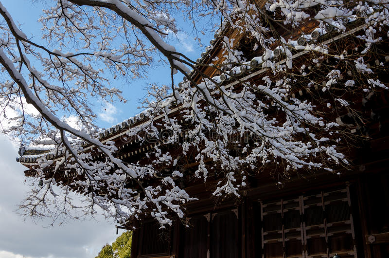 Frost covered temple, winter in Kyoto Japan. In winter, landscape of falling snow and frost covered temple and garden in Kyoto Japan royalty free stock image