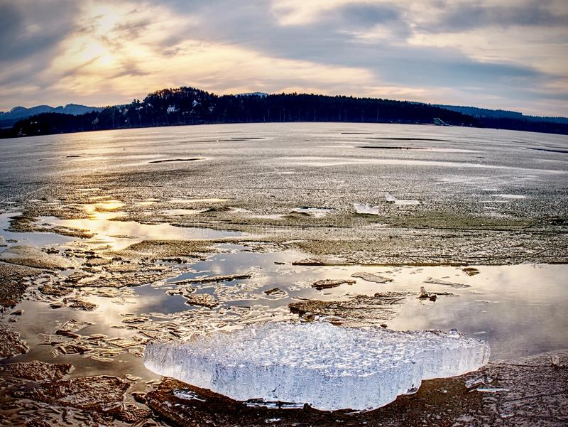 Frost crystal border between floe and dark water on lake. Natural view royalty free stock photos
