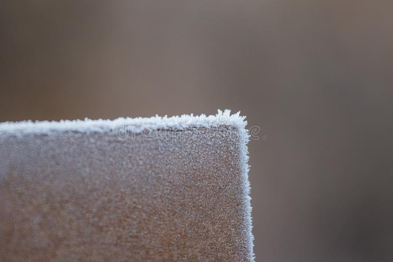Frost Crystals On Park Bench stock photo