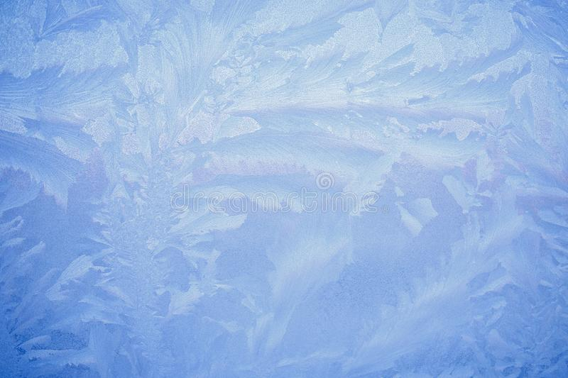 Frost drawing on window glass, snowflake ornament after anomaly ice cold stock images