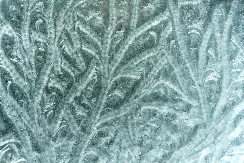 Frost on Glass Pattern. Natural pattern formed by frost on an outside glass table top royalty free stock photography