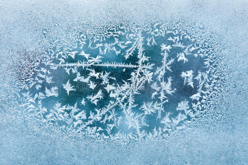 Frost. On the old scratched glass, texture. Focus on center stock photography