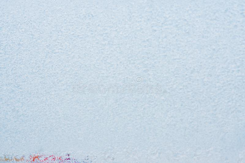 Frost patterns on frozen window as a symbol of Christmas wonder. Christmas or New Year background. Copy space.  stock photography