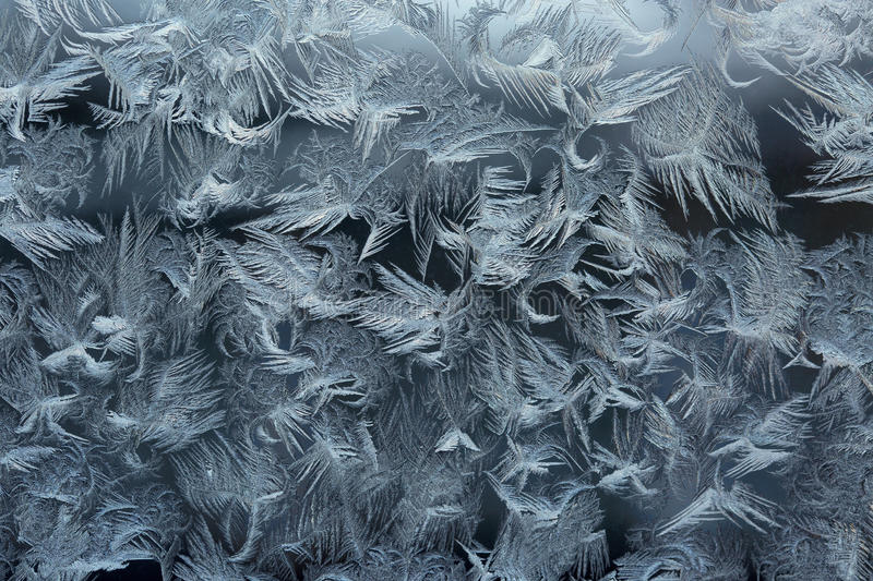 Frost patterns on a window pane stock photography