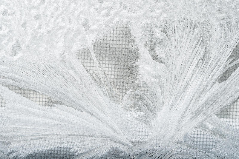 Frost and sreen. Frost on a windows with a screen in the back on a cold day royalty free stock photos