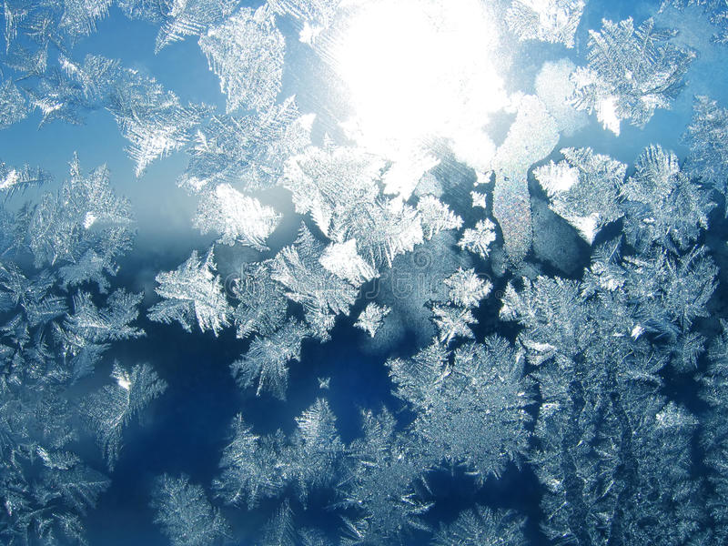 Frost and sun pattern. Natural frost and sun on winter window stock photography