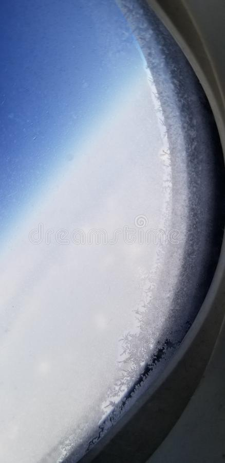 Frost On A Window. Frost on an airplane window from flying to Colorado stock images