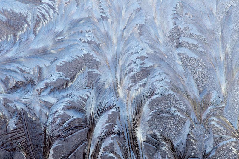 Frost on the window. Macro of abstract frost pattern on window stock images