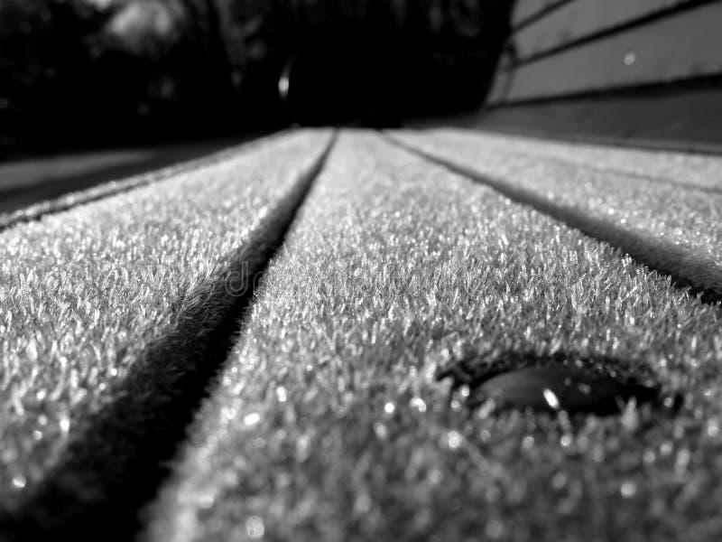 Frostad bänk arkivfoto