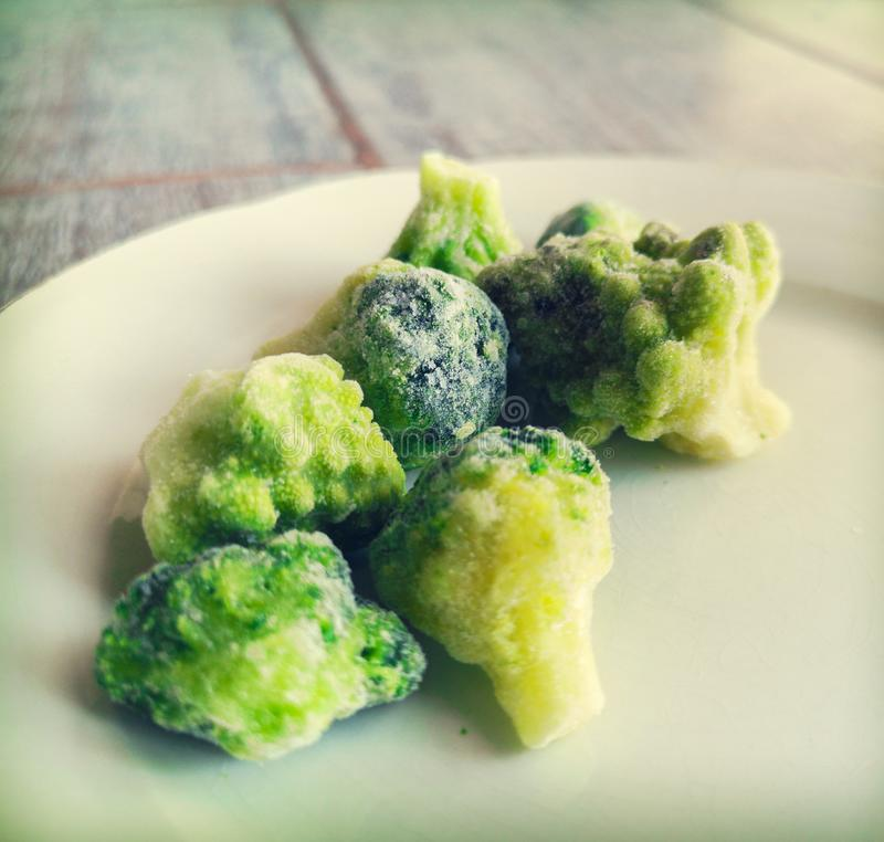 Frosted broccoli frozen veggies icing in freezer fridge royalty free stock photography