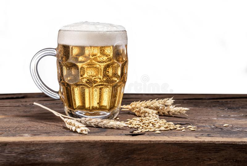 Frosted mug of beer on the wooden table. stock photography