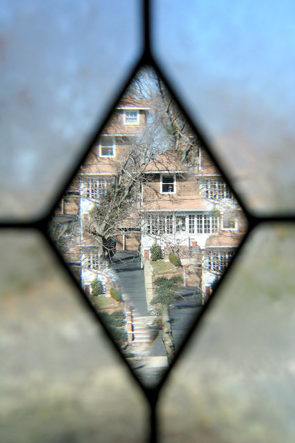 Frosted window. View of house through diamond-shaped frosted window royalty free stock photos