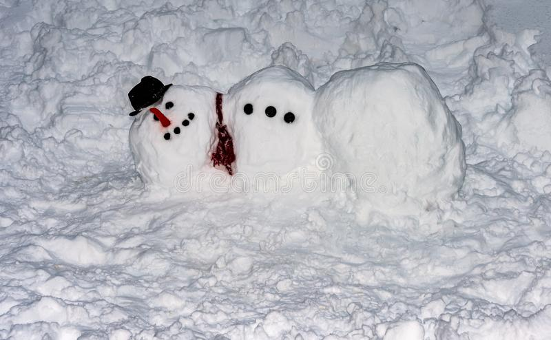 Frostigt snowmanen arkivbild