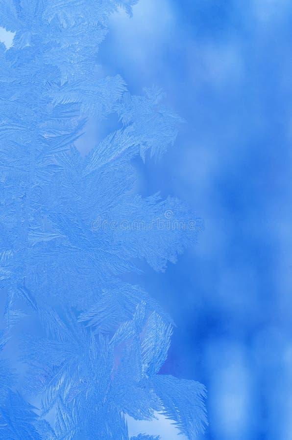 Frostmuster auf einem Fensterglas lizenzfreie stockfotografie