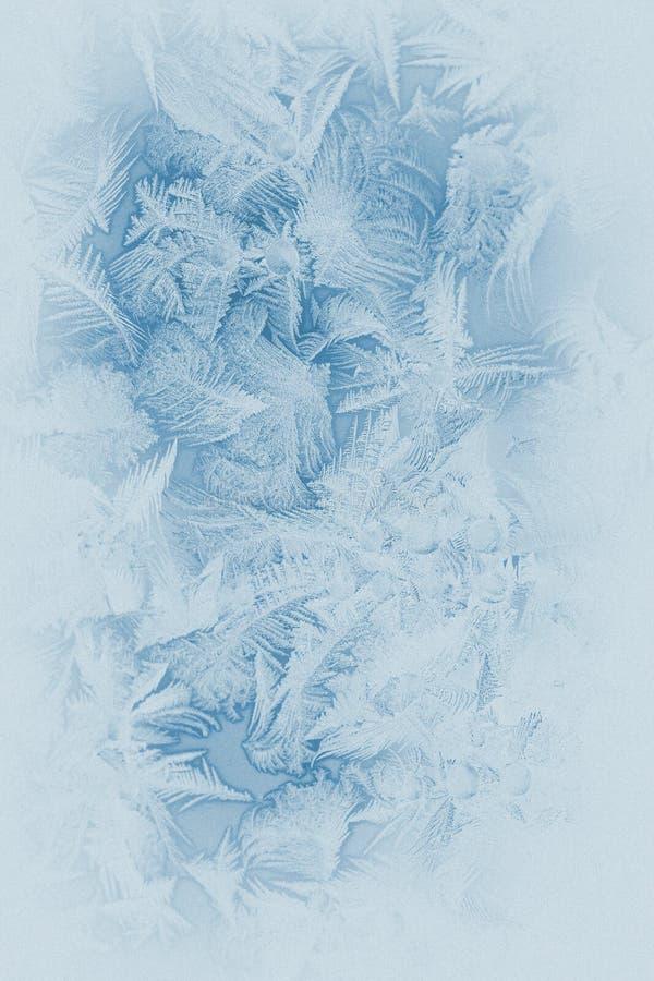 Frostmuster auf einem Fensterglas stockfoto