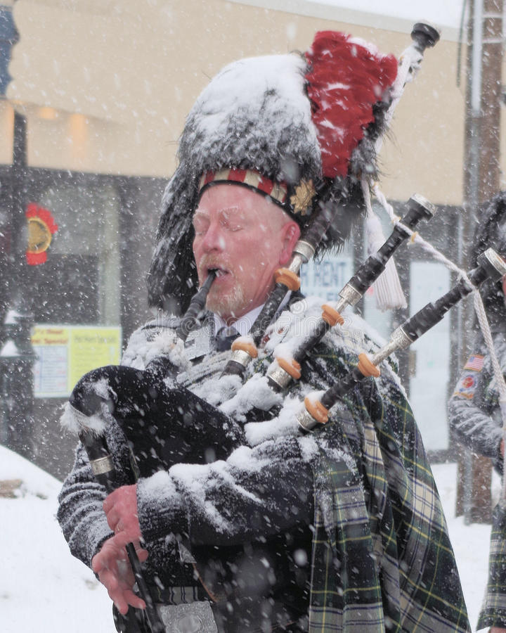 Frosty Bag Piper. Piper at the early St. Patrick's Day Parade in Bethpage, Long Island, New York stock photos