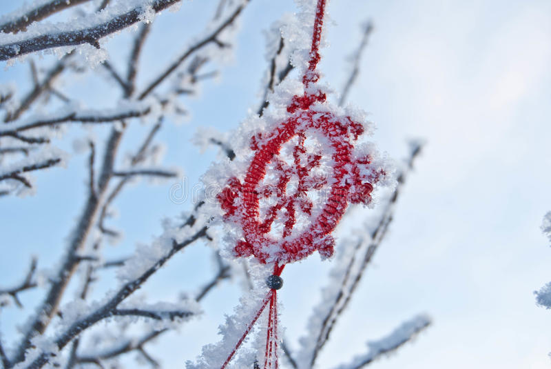 Frosty branches with Chinese wind chime. Winter scene of snowy tree top royalty free stock images
