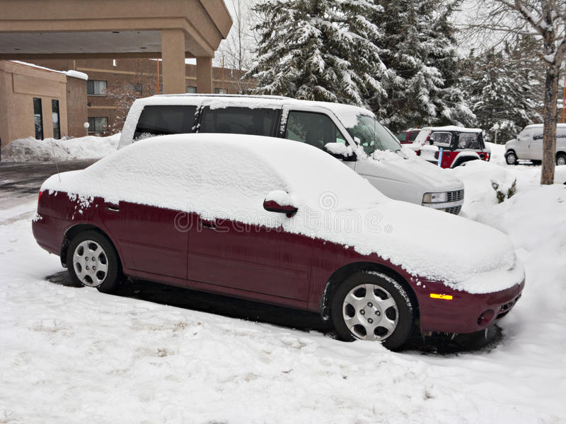 Download Christmas Snow Covering Cars At Parking Lot Stock Image - Image: 27449827