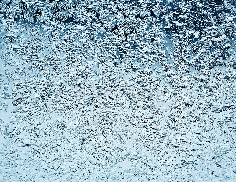 Frosty natural pattern on winter window.Frost patterns on glass. stock image