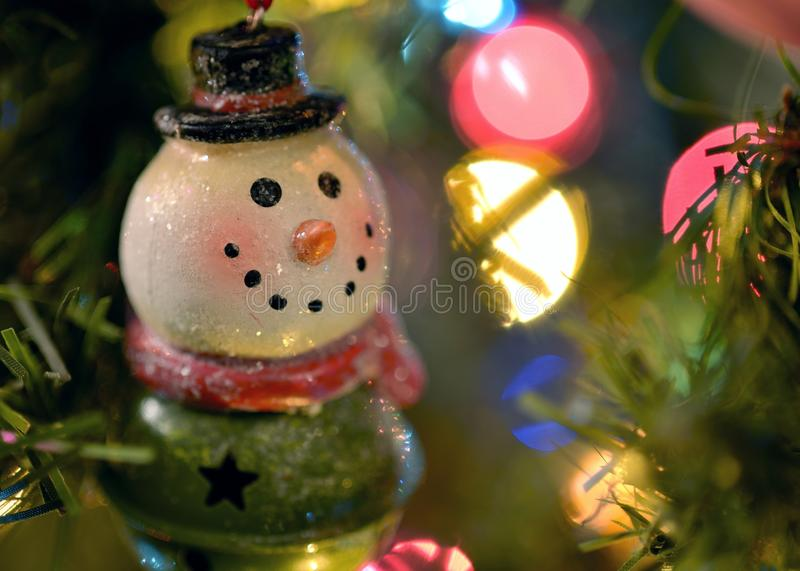 Frosty Ornament. A Frosty The Snowman ornament hanging on a Christmas trees. I thought this would be a nice picture for those looking for something Christmasy stock photos