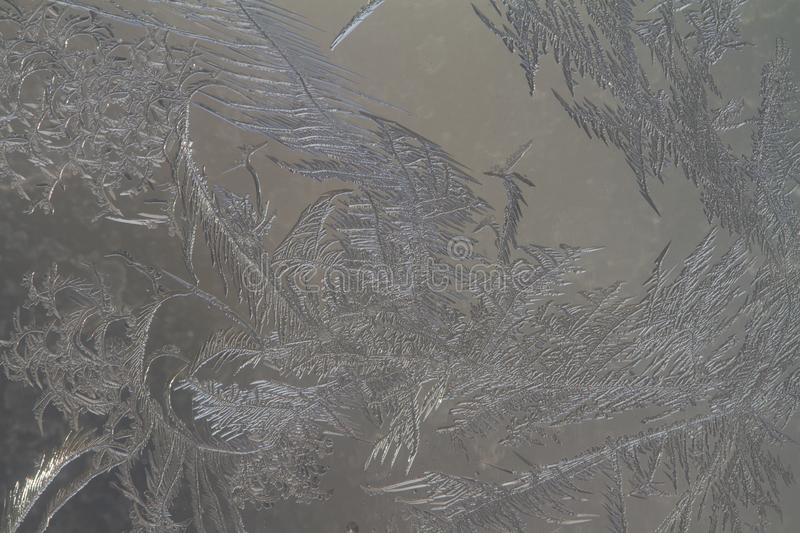Frosty pattern on the glass, beautiful pattern royalty free stock images