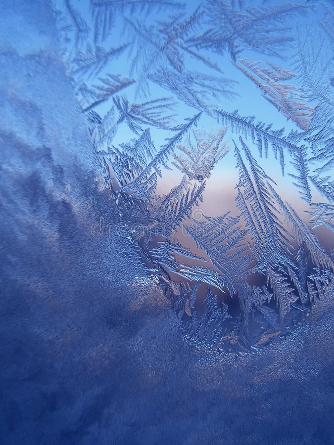 Frosty pattern at a window. On sunset stock image