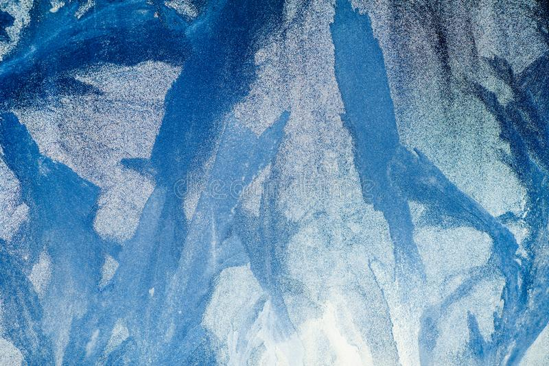 Frosty pattern on the window. Beautiful natural background. Winter theme. Close-up stock illustration