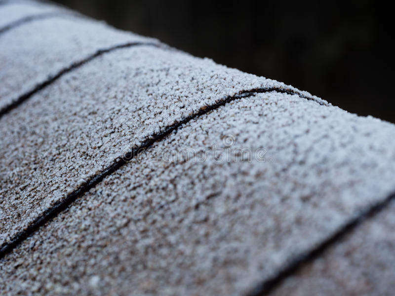 Frosty roof. Frost on the shingled roof stock photos