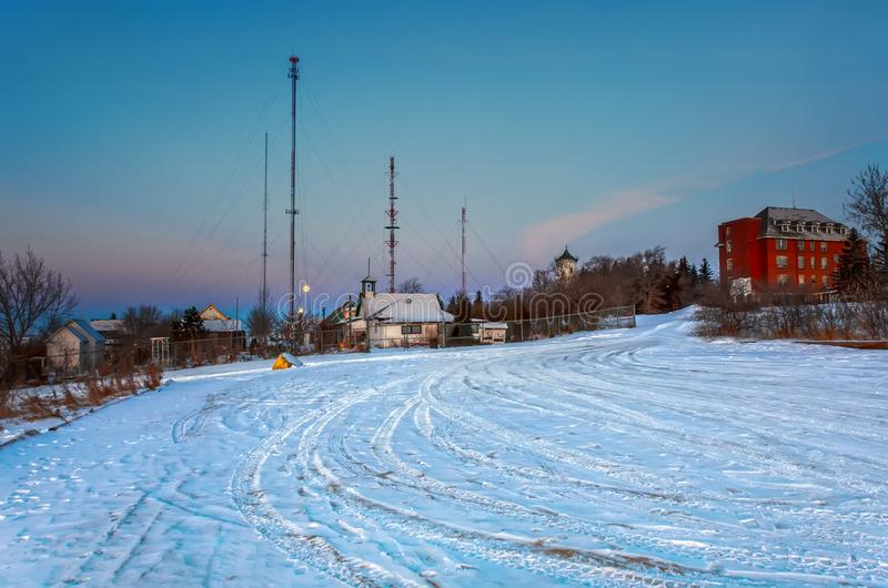 Frosty, snowy night with a blue sky at night in small heritage village stock image