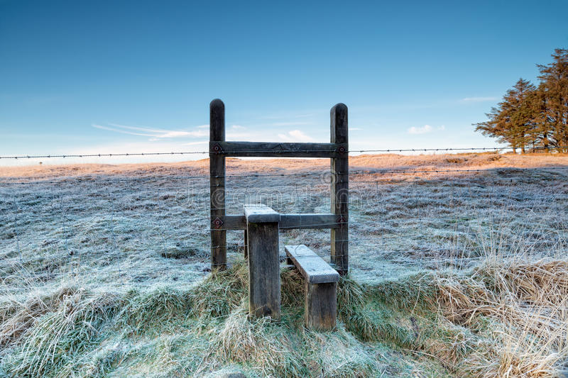 Frosty Stile. A frosty stile over a barbed wire fence on a cold winter morning on Bodmin Moor in Cornwall royalty free stock images