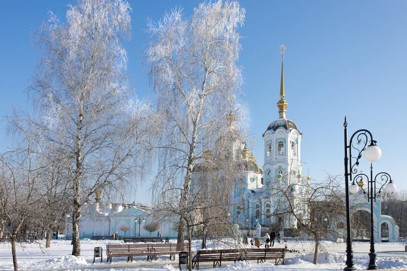 Frosty trees in the city in sunny winter day stock photography