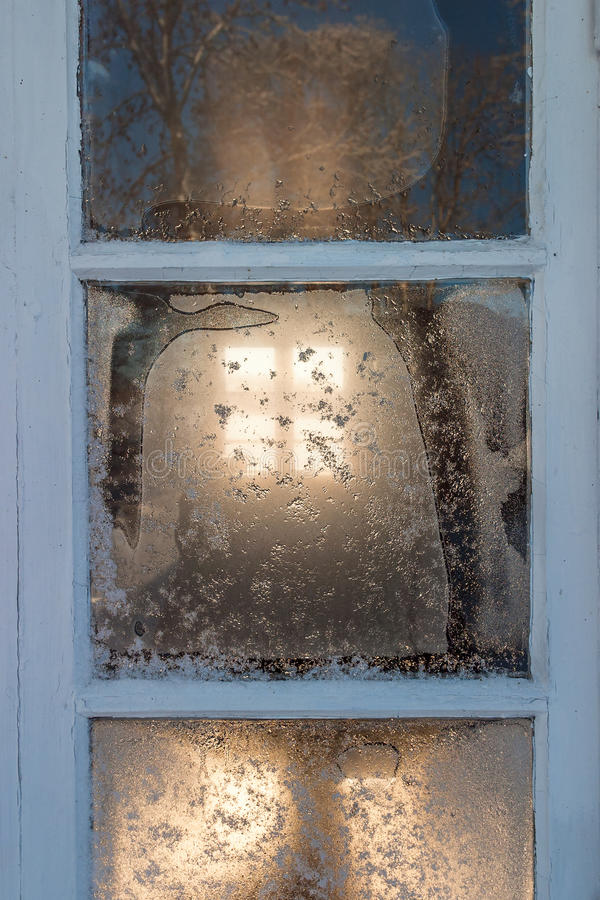 Frosty window at a cottage royalty free stock photo
