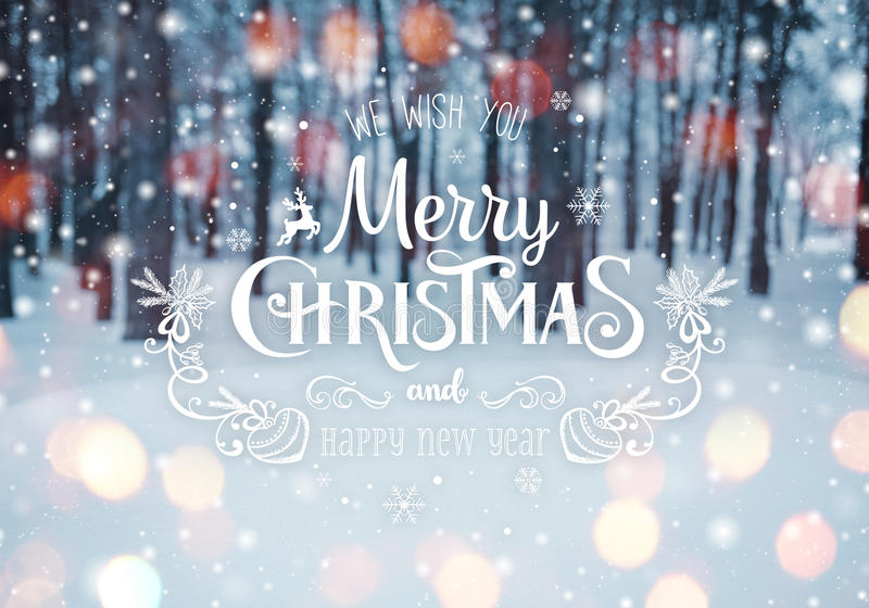 Frosty winter landscape in snowy forest. Christmas background with fir trees and blurred background of winter with text. Merry Christmas and Happy New Year royalty free stock photo