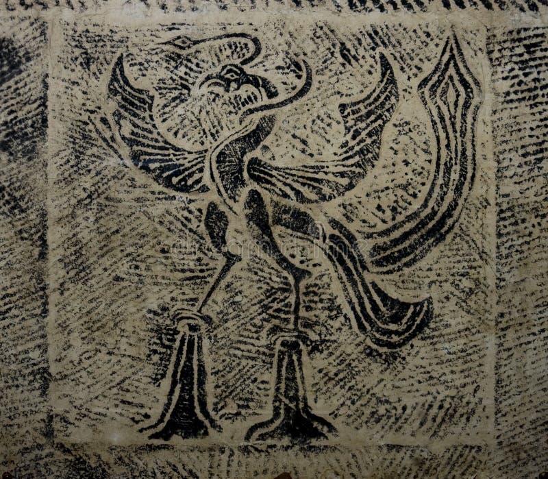 frotamiento de un pájaro antiguo de una tablilla imagen de archivo libre de regalías