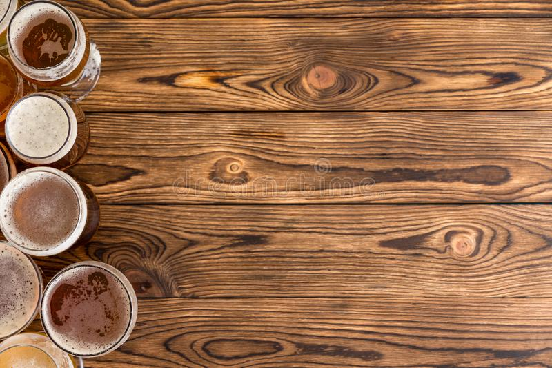 Frothy pints of beer on timber bar with copy space stock images