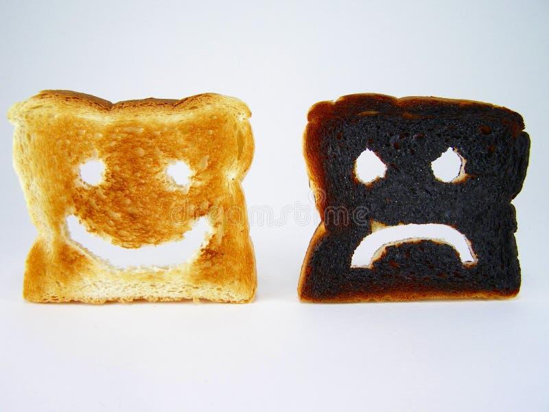 frowneysmileyrostat bröd fotografering för bildbyråer