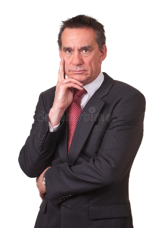 Frowning Angry Business Man in Suit. Frowning Angry Middle Age Business Man in Suit Holding Hand to Face stock photography