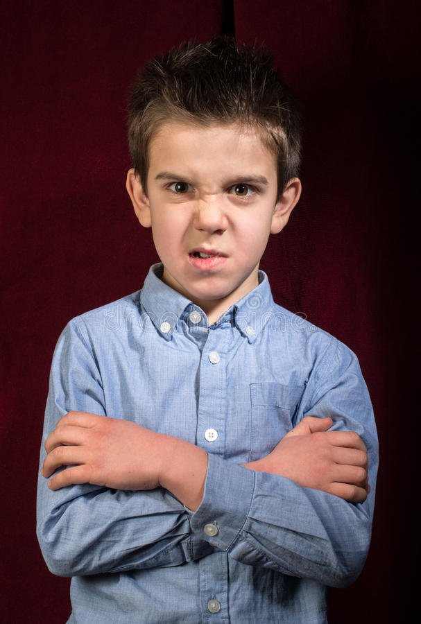Frowning boy royalty free stock photography