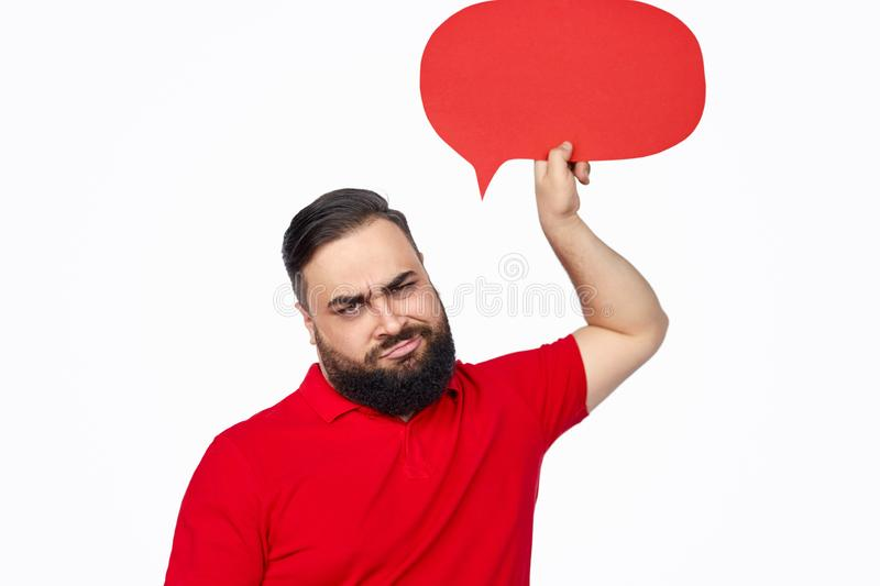 Frowning ethnic guy with speech balloon royalty free stock image