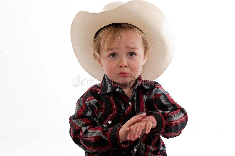 Frowning little cowboy stock images